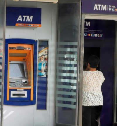 Person Using An ATM Machine Free Stock Photo - Public ...