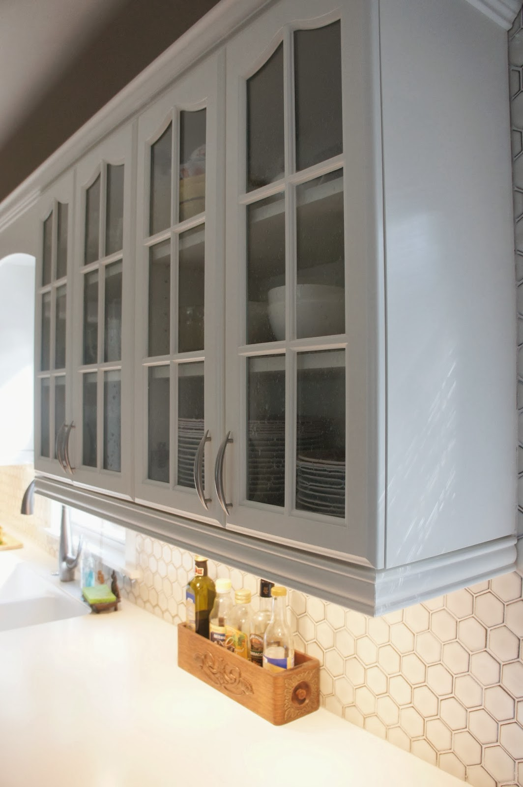 Gray and White Kitchen Makeover with Hexagon Tile Backsplash two tone kitchen cabinets two tone gray and white kitchen cabinets LoveLee Homemaker featured on Remodelaholic