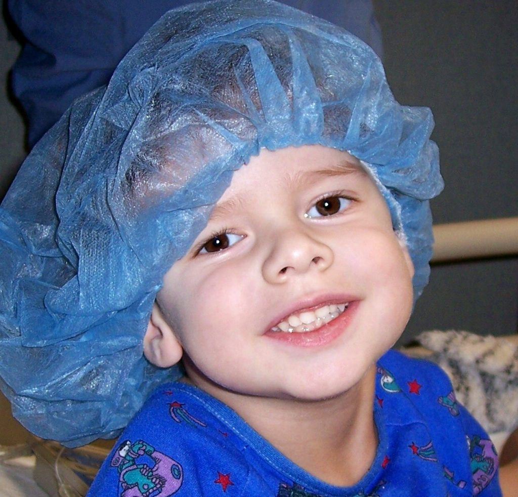 Kid with hair net on in the hospital