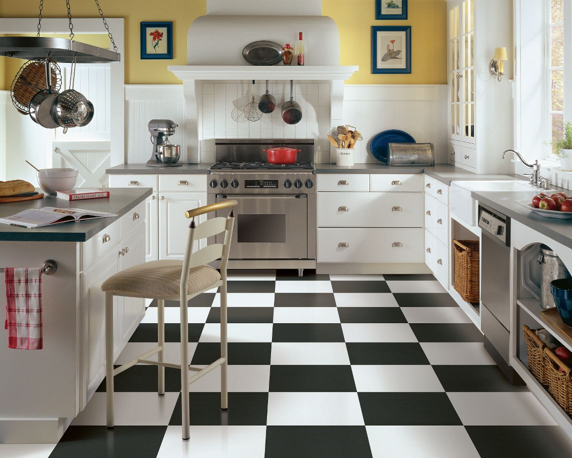 tips to match your kitchen floor for your lifestyle kitchen flooring vinyl These checkerboard vinyl tiles in a classic kitchen design make a great design statement are affordable and will stand up well to years of use if well