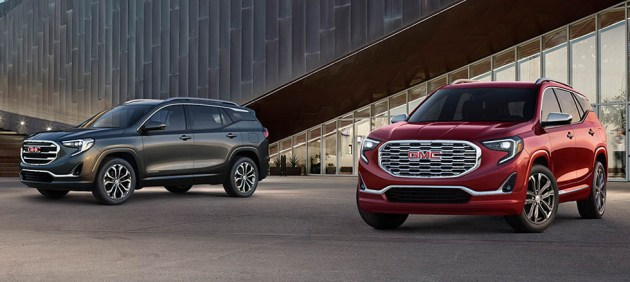 How Does the 2018 GMC Terrain Compare to the 2017 Model    Zimbrick     Two 2018 GMC Terrains  One is red and the other is gray  They are