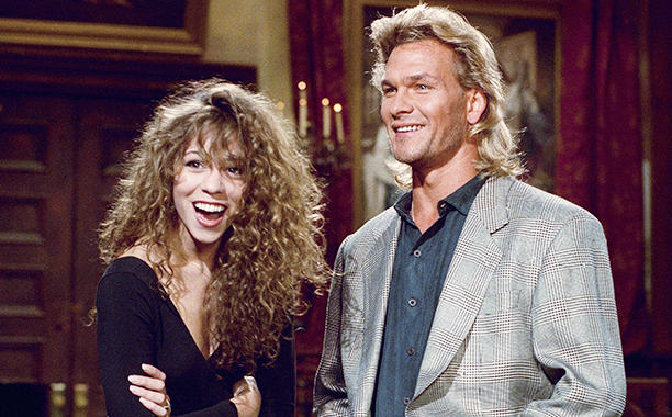 "Actor Patrick Swayze, right, and musical guest Mariah Carey rehearse Friday, Oct. 26, 1990 in New York for the Saturday, Oct. 27 broadcast of ""Saturday Night Live"" in New York. (AP Photo/Richard Drew)"