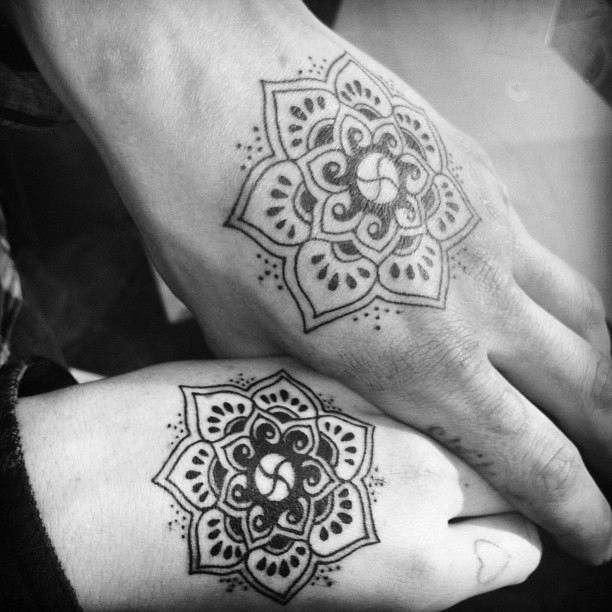 Me and my Boy's tattoo. Hindu symbol for happiness