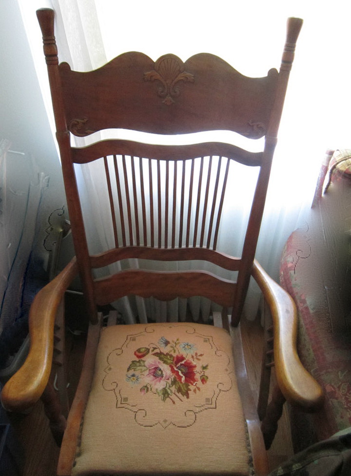 Old Glider Rocking Chair