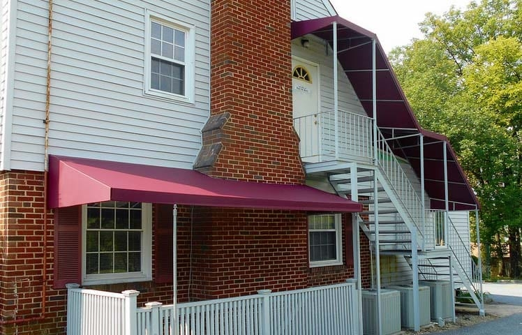 Basement Awnings And Stairway Awnings A Hoffman   Exterior Basement Entrance Stairs   Closed   Precast Concrete   Stone Wall   Daylight Window   Bedroom