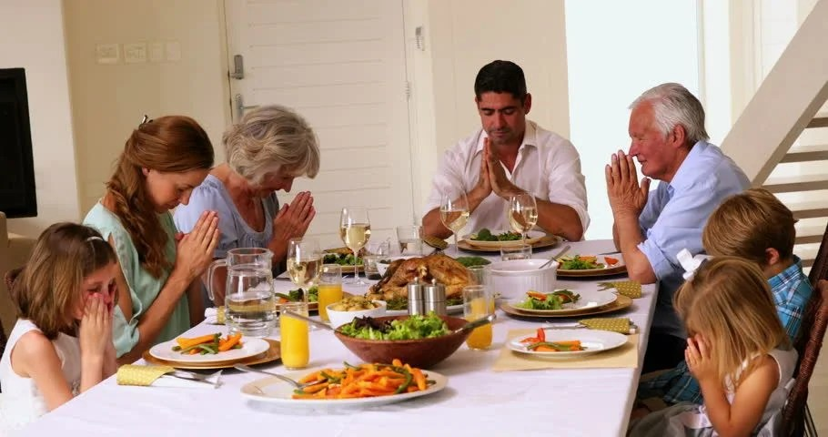 Extended Family Praying Together Before Stock Footage ...