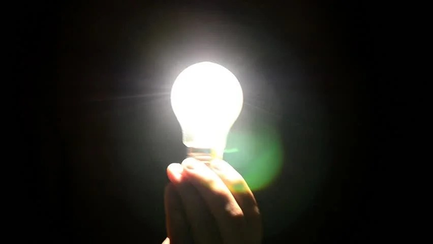 Hand Holding A Light Bulb Stock Footage Video 100