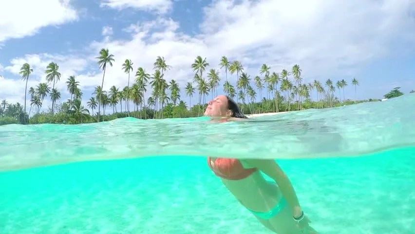 SLOW MOTION UNDERWATER: Young Woman In Bikini Swimming In ...