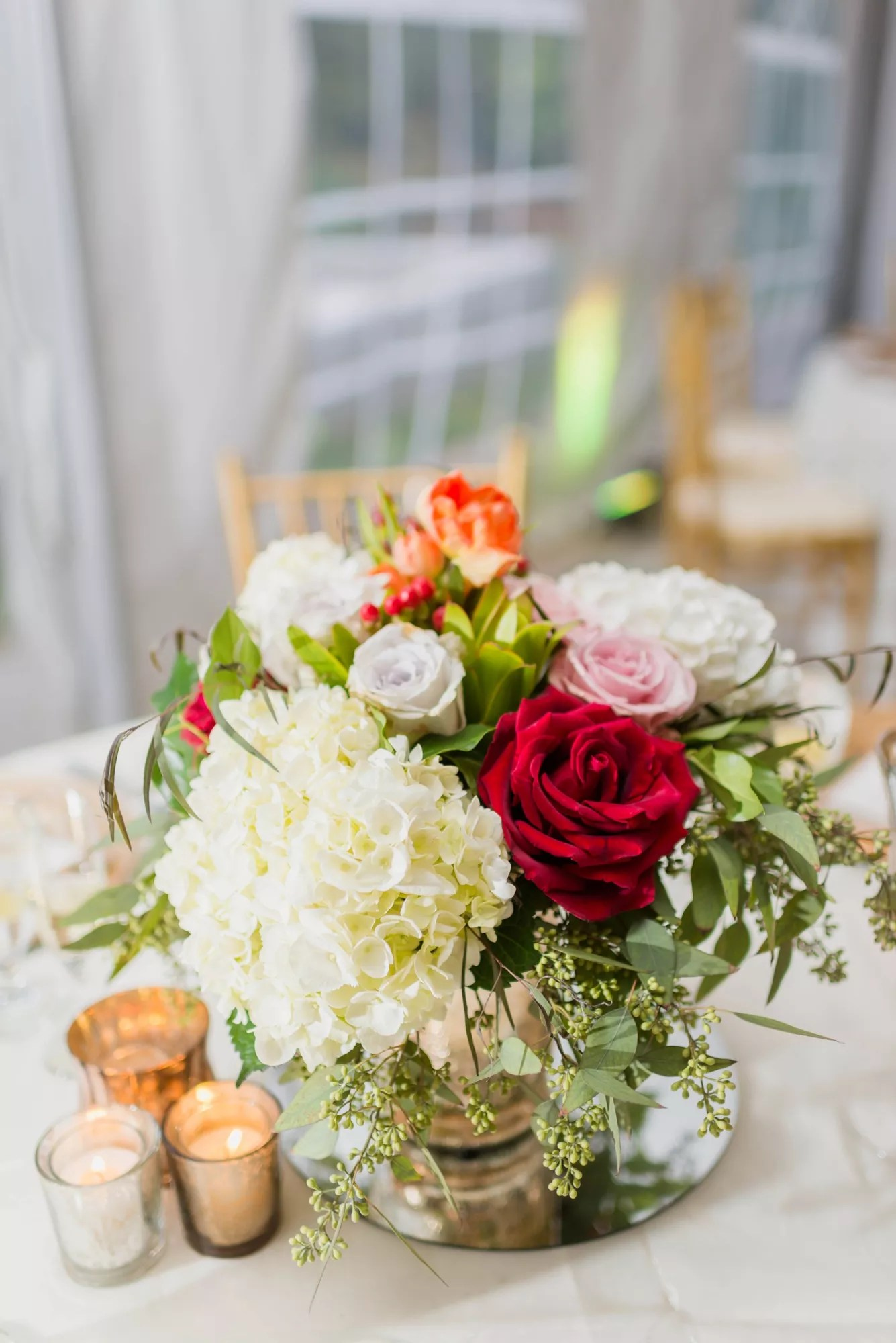 White Hydrangea And Red And Pink Rose Centerpieces