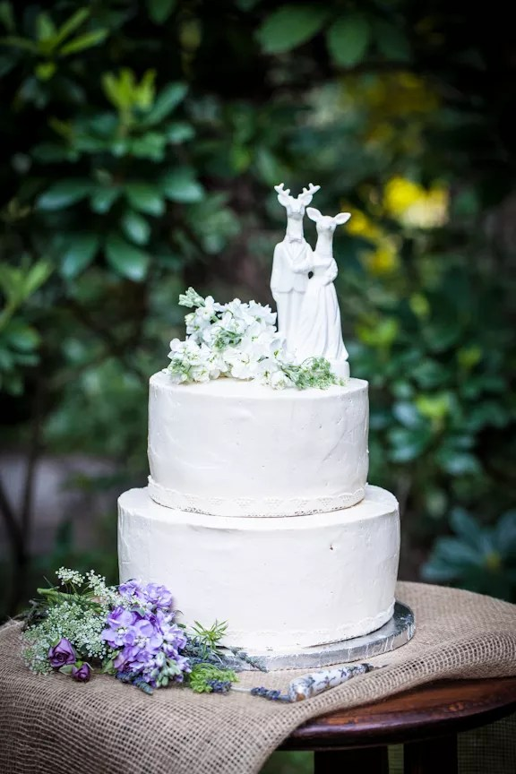 Simple Round Wedding Cake With Whimsical Deer Topper