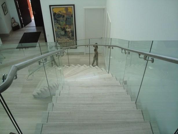 Frameless Curved Glass Railings In Residential Home Bella Stairs | Curved Glass Stair Railing | Residential Glass | Commercial Glass | Band Glass | Walnut | Frameless Glass