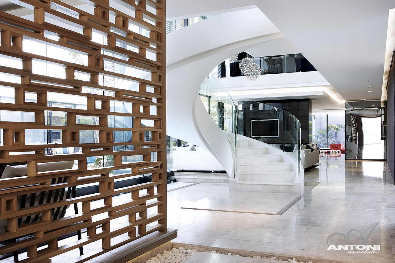 Modern Mansion With Perfect Interiors by SAOTA   Architecture Beast Impressive spiral staircase in modern mansion