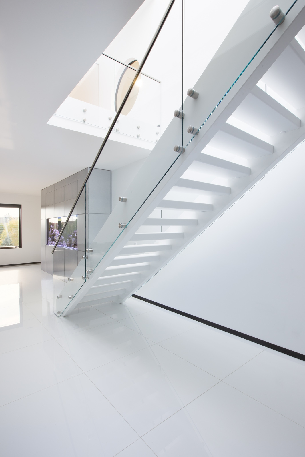 Modern White Staircase Design On Architizer | White And Glass Staircase | Before And After | American White Oak | Luxurious | High End Glass | White Handrail Treads