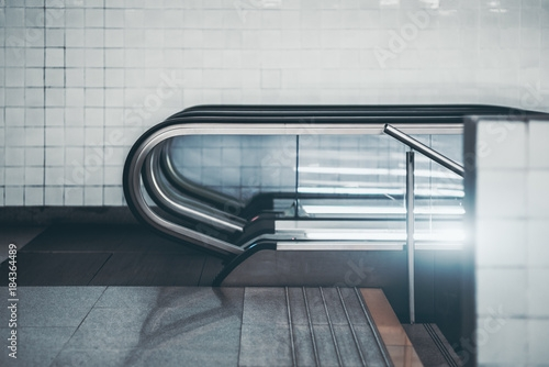 Side View Of Modern Glass And Chrome Escalator In Urban | Glass And Chrome Staircase | Contemporary | White Post | Single Spine | Lights | Stainless Steel