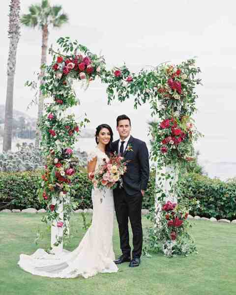 59 Wedding Arches That Will Instantly Upgrade Your Ceremony   Martha     Floral Wedding Arch with Roses  Vines and Berries