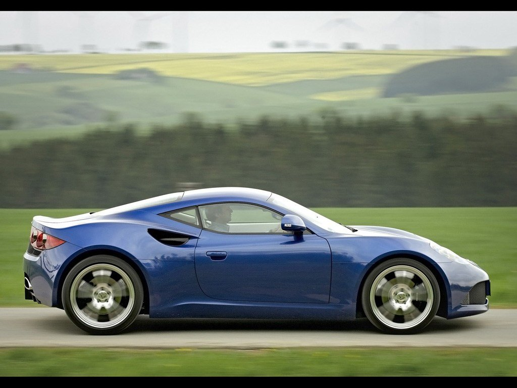 Latest 2011 Artega Gt Blue Side Speed 1024X768 Wallpaper Free Download