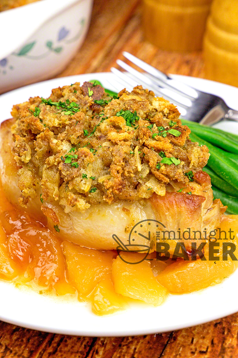 Awesome pork chops are baked on a bed of apples and topped with super-savory stuffing. Your family will beg for seconds!