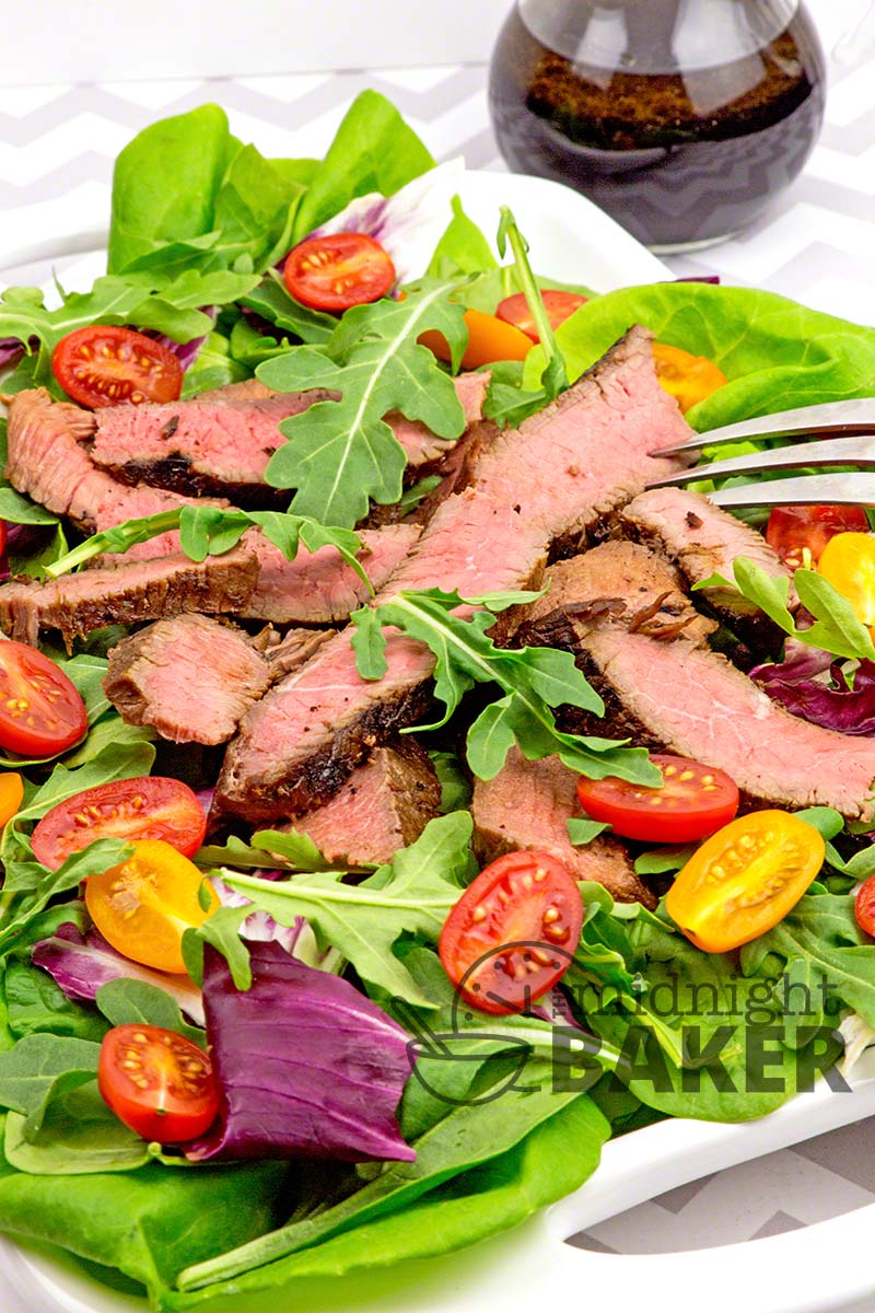 Delicious teriyaki-marinated london broil on a bed of mixed greens makes a cooling summer meal. Sesame soy dressing is the crowning glory to this healthy and easy summer meal.