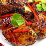 Yummy pork baby back ribs with a sweet and tangy Thai chili sauce glaze