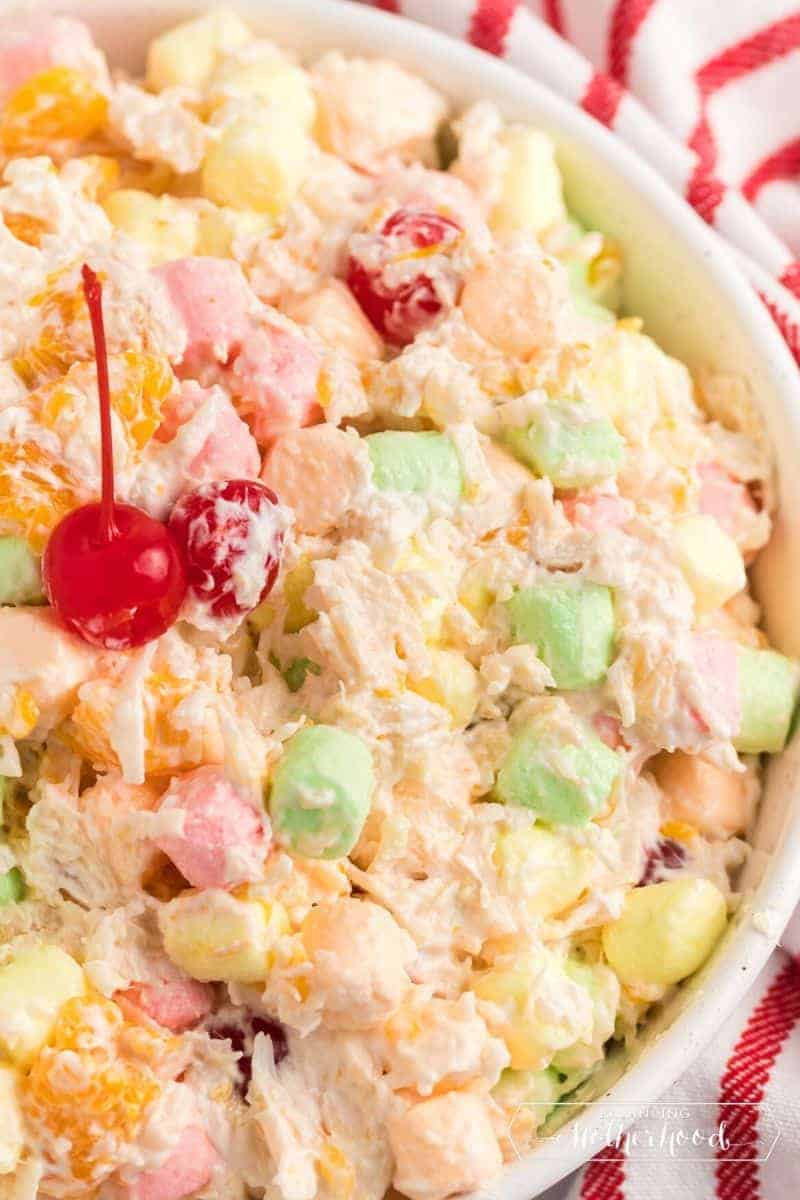 close up of ambrosia salad with cherry on top