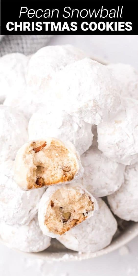 Snowball cookies are a Christmas classic made with powdered sugar and creamy butter with crushed pecans. All rolled in more powdered sugar for the perfect holiday cookie!