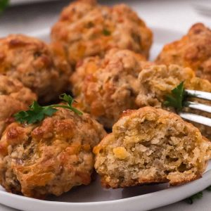 sausage balls on plate with a bit out