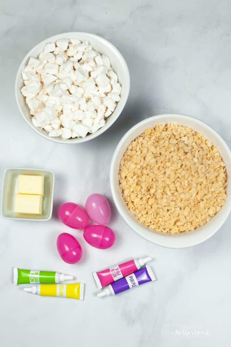 rice crispy treat Easter egg ingredients: mini marshmallows, crispy treat cereal, butter, plastic eggs, and food coloring