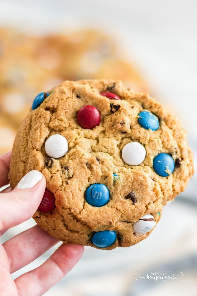 large cookie being held up