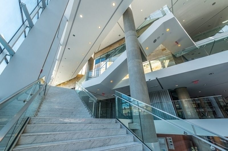 Different Types Of Commercial Staircases You Can Opt For | Staircase Design For Commercial Buildings | Cylindrical Glass | Enclosed | Beautiful | Central Staircase | Sleek