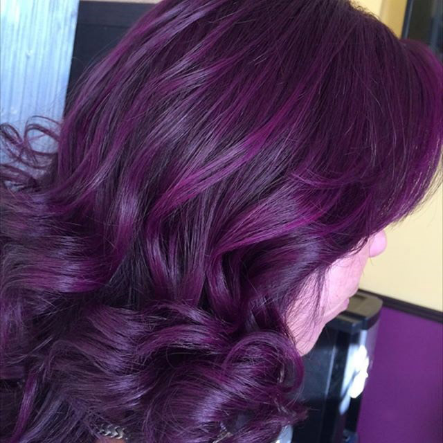 Long black hairstyles with plum highlights