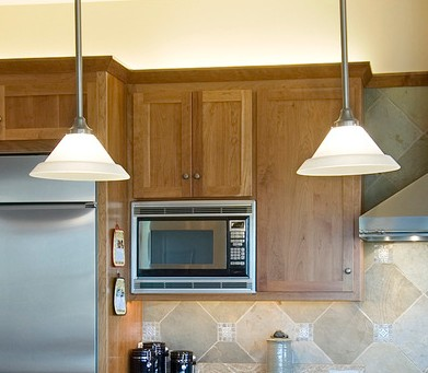 hanging lights over a kitchen island # 37