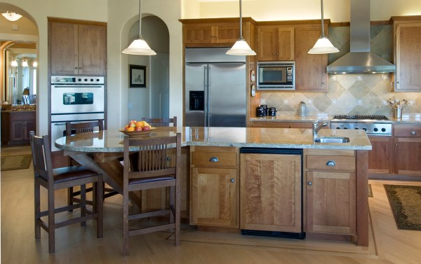 hanging lights over a kitchen island # 11