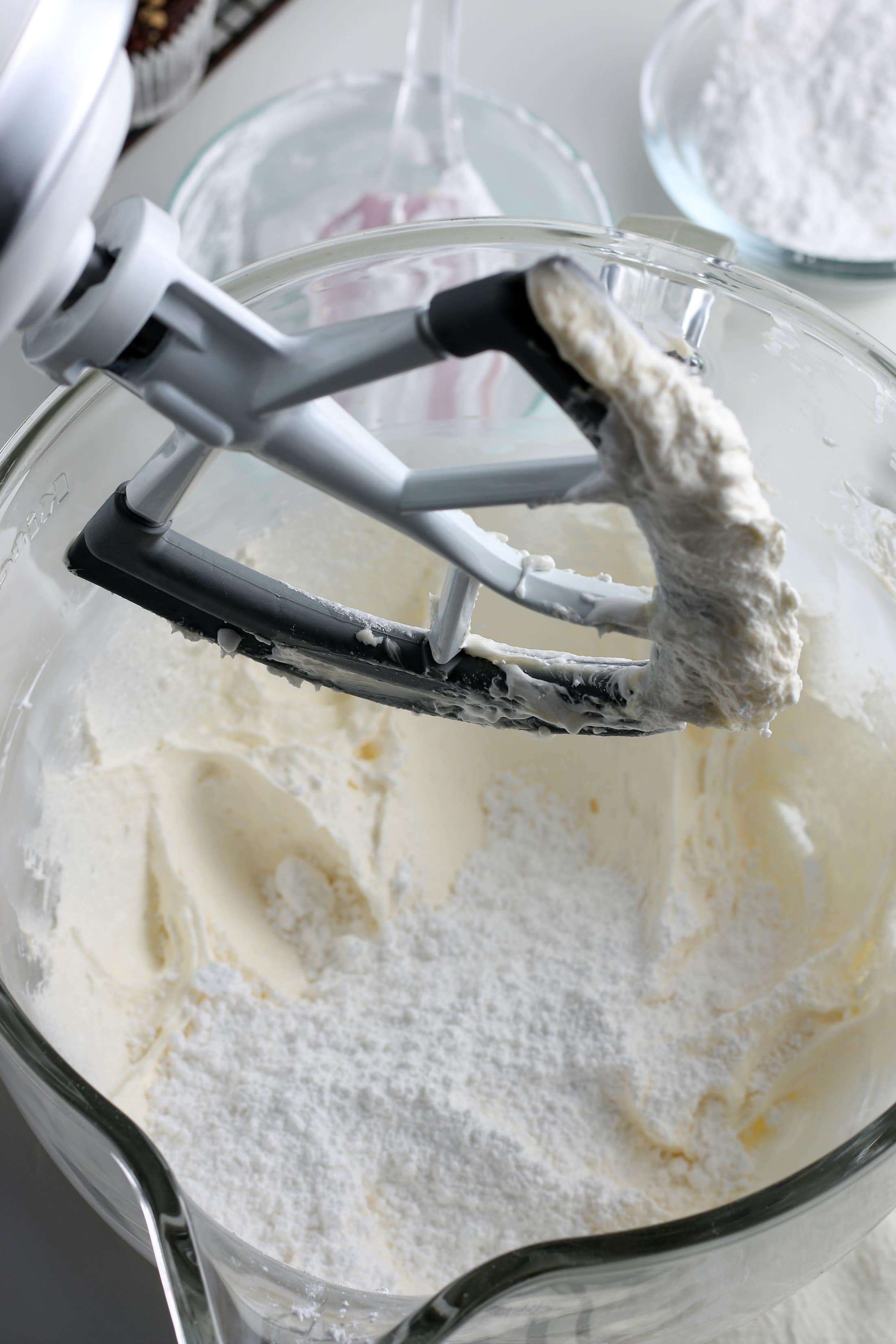 powdered sugar with marshmallow cream combination in a glass mixing bowl