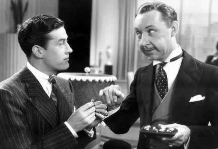 Ray Milland and Franklin Pangborn in Three Smart Girls (1936)