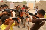 Iraqi boys play with toy guns to celebrate Eid al-Fitr in Baghdad on October 3, 2008