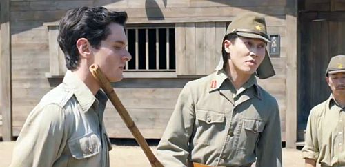 Jolie seems to use the relationship of Zamperini and the guard to show two directions of childhood pain.  (screenshot from Unbroken with Jack O'Connell and Miyavi)