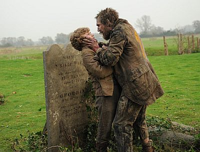 Ralph Fiennes as Magwitch and Toby Irvine as young Pip in Mike Newell's Great Expectations (2012)