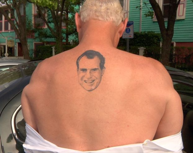 Roger Stone displays his famous tattoo of his hero Richard Nixon