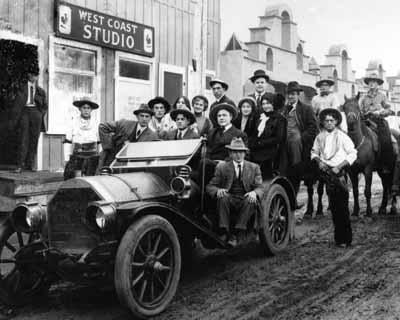 Young Deer (behind wheel) in front of Pathe West Coast studio in Edendale, circa 1911. Red Wing (without hat) stands behind him. Photo courtesy of Marc Wanamaker.