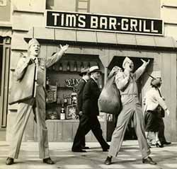 Dan Dailey and Kelly in front of Tim's Bar