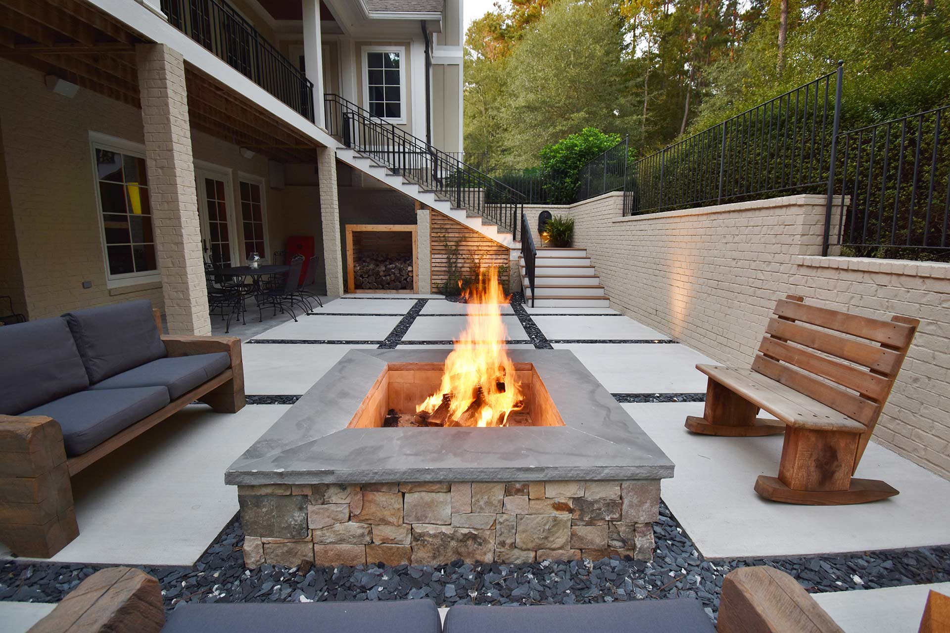 Concrete Squares And Slate Chips Patio With Custom Fire Pit