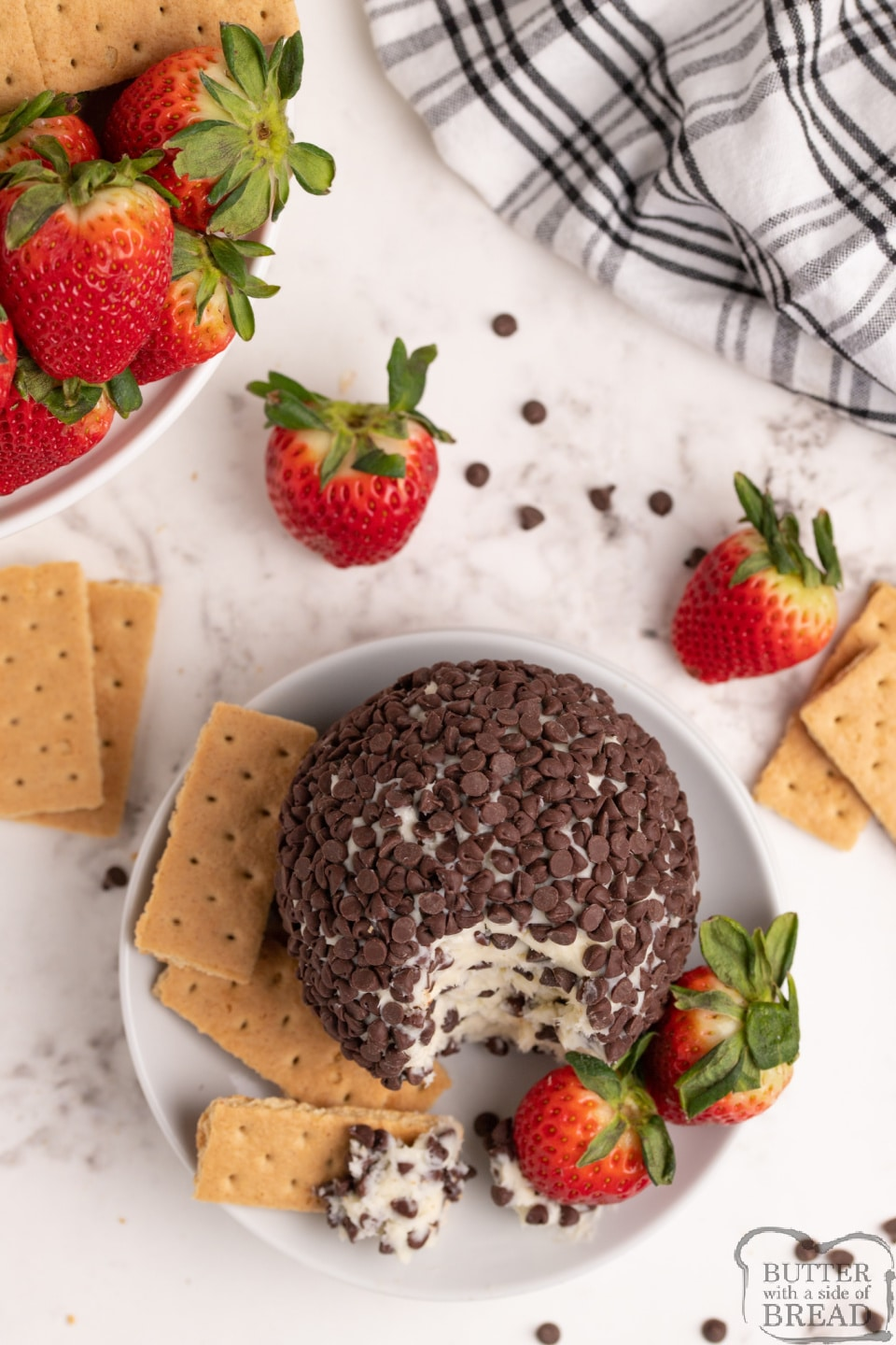 Cheesecake Cheese Ball recipe made with only 5 ingredients for an easy appetizer! This chocolate chip cheesecake cheese ball pairs perfectly with fresh strawberries and graham crackers and only takes a few minutes to make!