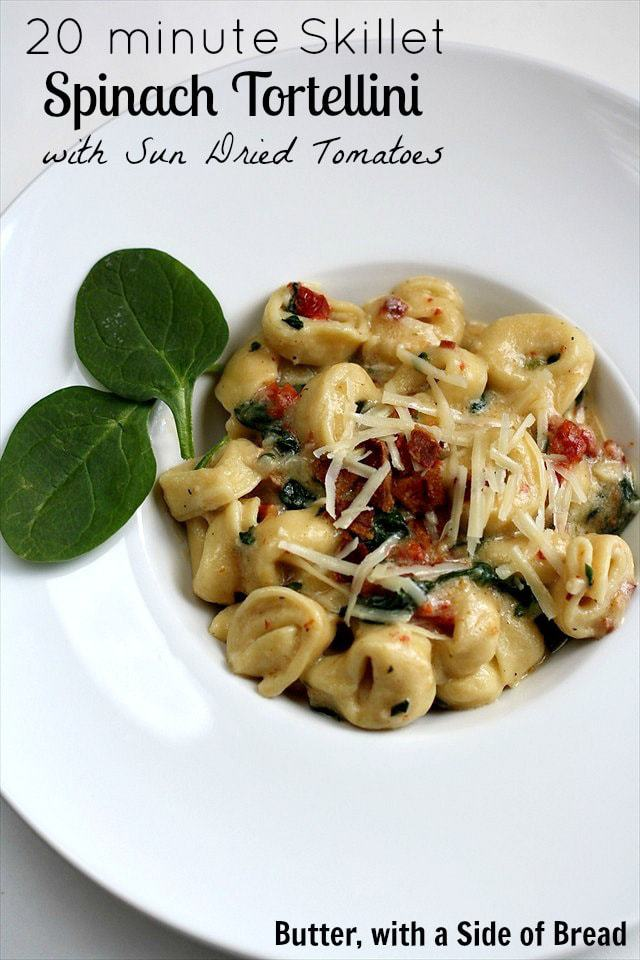 Skillet spinach tortellini with sun dried tomatoes is a one pot dinner that you're going to love on busy nights. With a creamy lemon sauce, fresh spinach, and frozen tortellini, this dinner is healthy, easy, and delicious.