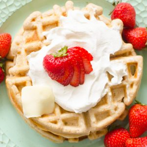 oatmeal cinnamon waffles with whipped cream and strawberries