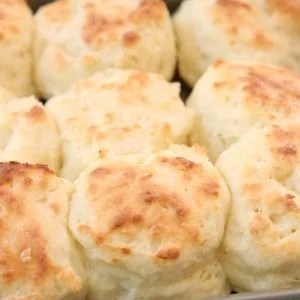 Easy Sour Cream Biscuit Recipe made from scratch in minutes. Perfect soft, flaky texture with fantastic buttery flavor. This will be your new favorite biscuit recipe! Updated with expert advice on how to make the best homemade biscuits.