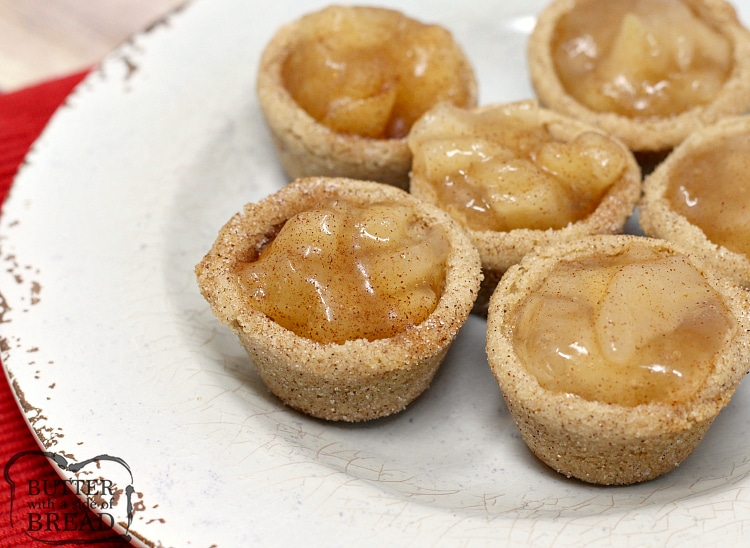 Snickerdoodle Apple Pie Cookie Cups combine two favorite desserts in a bite sized treat! Mini apple pies with a delicious, homemade snickerdoodle cookie crust!