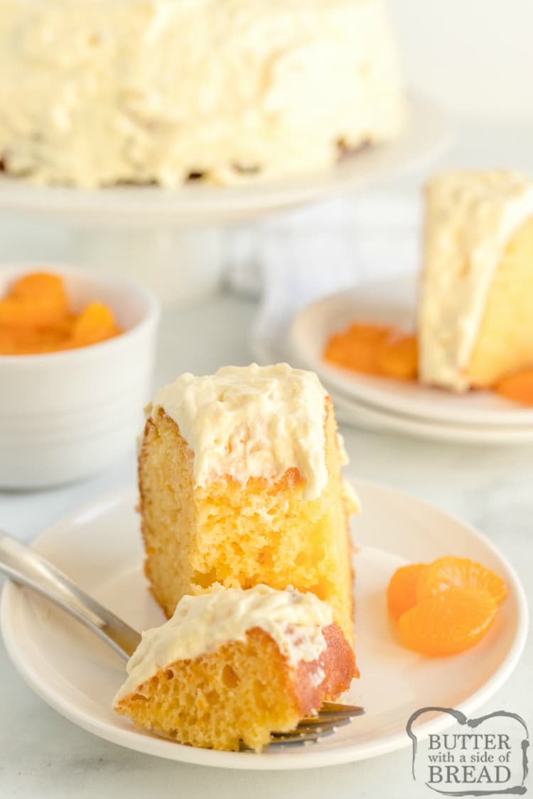 Mandarin Orange Cake with Pineapple Frosting is so light and refreshing and begins with a cake mix and mandarin oranges, then topped with a frosting made with crushed pineapple and vanilla pudding. Also known as Pig Pickin' cake, this simple cake recipe is absolutely amazing!