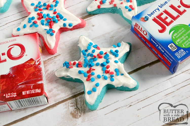 Patriotic Jello Sugar Cookies are easy to make with red and blue jello and a simple buttercream frosting that can be flavored to match! These sugar cookies can be rolled and cut out into shapes or just quickly scooped out into balls.