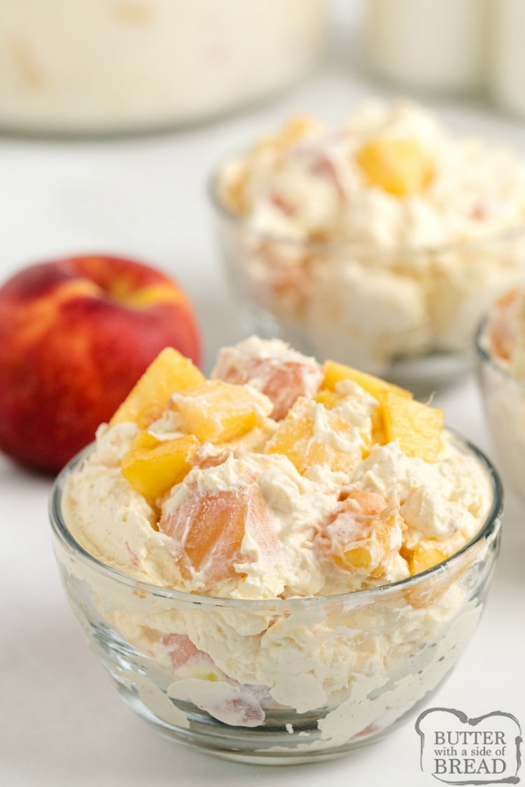 Fresh peaches in creamy fruit salad