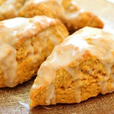 Easy Pumpkin Scones recipe made with pumpkin, cinnamon, brown sugar and butter. Soft & sweet pumpkin scones that are perfect for Fall.